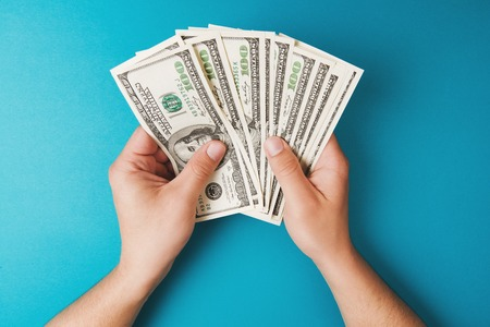 allocation: Man counting money, economy concept, allocation of money