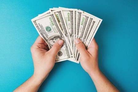 Man counting money, economy concept, allocation of money