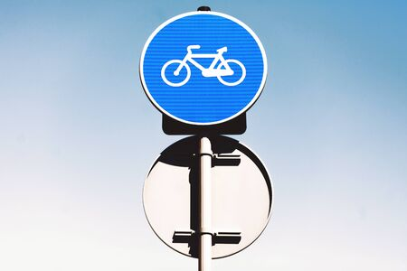 bicycle lane: Round bicycle lane sign against a blue sky