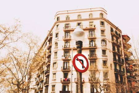 constraint: Close up No left signs on the trees, buildings and sky background in Barselona