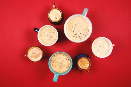Still: Many different cups of coffee and cappuccino on red background