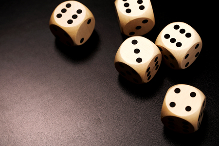 dados: Many wooden dices on a black background.