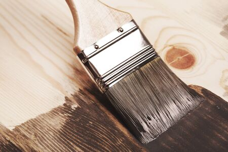 home decorated: Grey color painting on wooden table or fence or wall, or flour, use for home decorated. House renovation. Half - painted surface. Smear of paint brush.