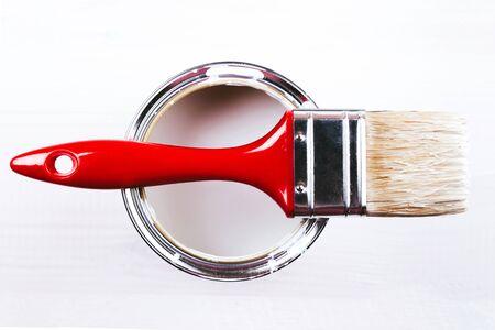 Varnishing and painting a wooden shelf using paintbrush Stock Photo