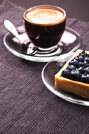 blueberry pie: Blueberry pie and coffee on a dark background