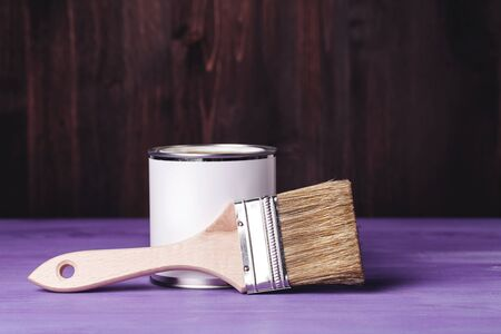 lacquer: Paint can with brush, lacquer or varnishing wooden floor.