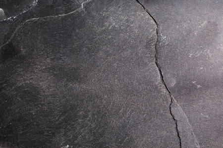 blemished: Black stone background. Abstract textured stone grunge surface. Stock Photo