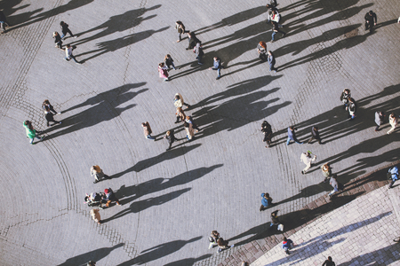 View on people from the tower of St. Mary's Church, Kosciol Mariacki. Background of people with lolg shadows. top view. 免版税图像 - 54920891