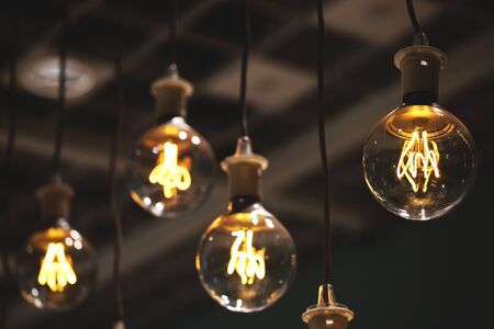 Group of lamps with interesting shape of tungsten filament. Stock Photo