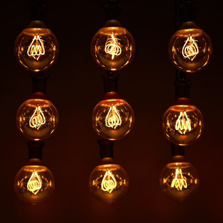 tungsten: Group of lamps with interesting shape of tungsten filament. Modern lighting of cafe and restaurant.