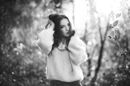 sexy sweater: Young sexy thoughtful woman with long hair in fluffy sweater, black and white. Stock Photo
