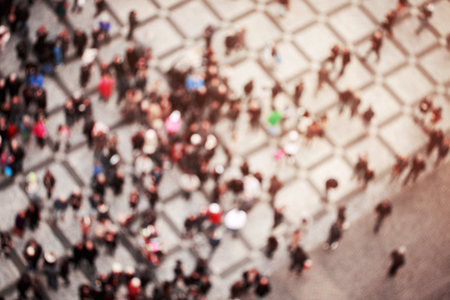 Blurred crowd of people in multicolored clothes in the city. Top view Stock Photo