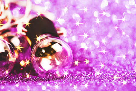 Glittering shine lights background with violet sparkles and many little bulbs. Festive background. Stock Photo