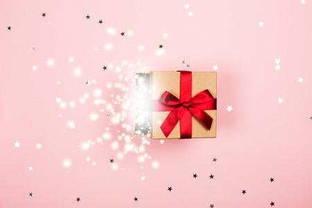 Present with red bow and magic inside.