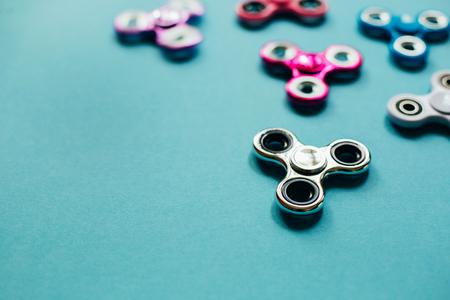 energy needs: Set of fidget spinners on blue background.