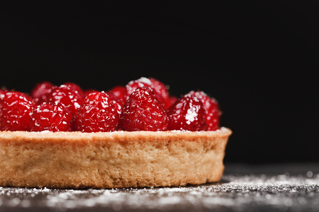 Tartlet with custard and fresh raspberries Stock fotó