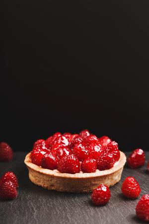 Tartlet with custard and fresh raspberries Stock fotó