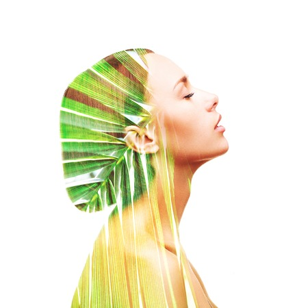 Profile beautiful woman and palm leaf Banque d'images