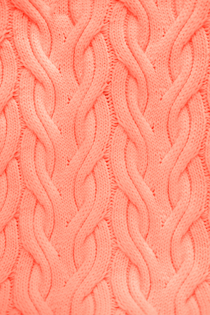 Knitted Living Coral texture. Color of the year 2019 concept. 版權商用圖片