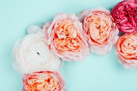Background Made of pink and orange beautiful roses. Ispired by color of the year 2019 - Living Coral.
