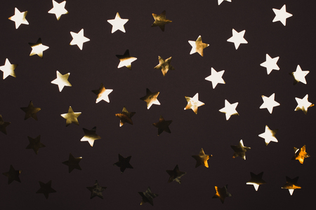 Many beautiful golden stars on pink background. Flat lay style. Reklamní fotografie