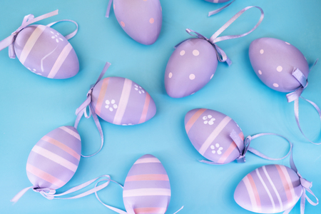Easter pattern of decorative grey eggs on blue pastel background. Top view. Imagens