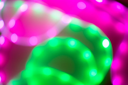 Abstract background of blurred neon green and purple lines. Trend of 80s colors. Imagens
