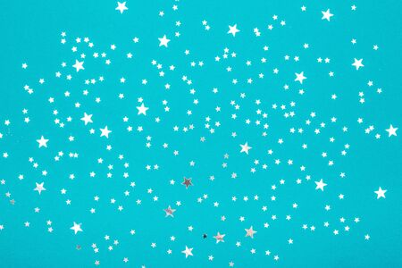 Silver stars with glitter on blue background