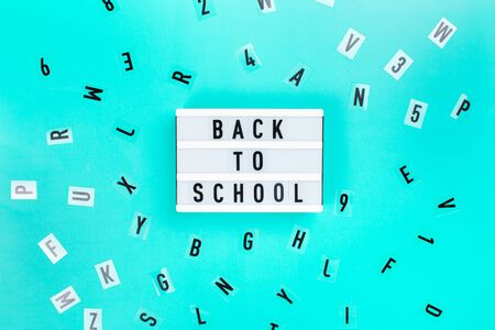 Back to school concept. Letters on blue background.