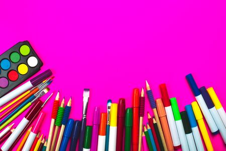 School supplies on pink neon background and note book with copy space. Back to school concept. Фото со стока