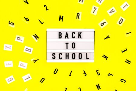 Back to school concept. Letters on yellow background.