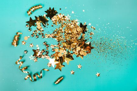 Golden sparkles on blue background. Holiday concept. Stock Photo