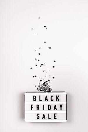 Light board with text Black Friday Sale on grey background. Stock Photo