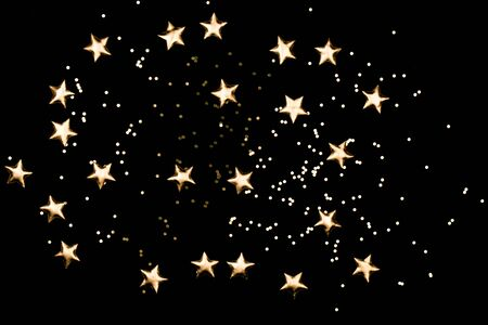 Black background with gold stars. Perfect star overlay. Фото со стока