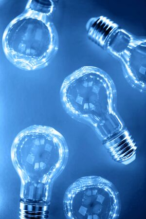 Creative pattern made of light bulbs in blue light. Flat lay. Macro. Фото со стока