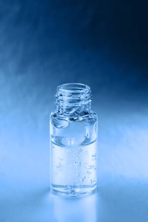 Macro photo of bottle with fluid collagen of hyaluronic acid