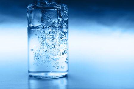 Macro photo of bottle with fluid collagen of hyaluronic acid Фото со стока - 135464665