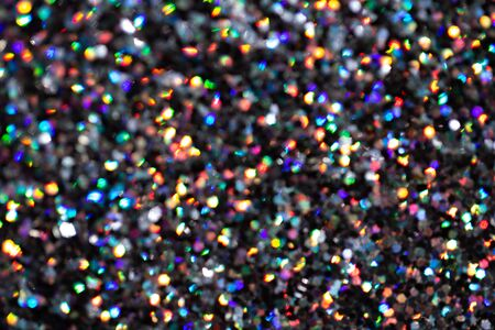 Blurred background with holographic sparkles and lights.