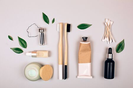 Zero waste self-care products. Bamboo toothbrush, toothpaste, tooth powder and flax. Flat lay style. Фото со стока
