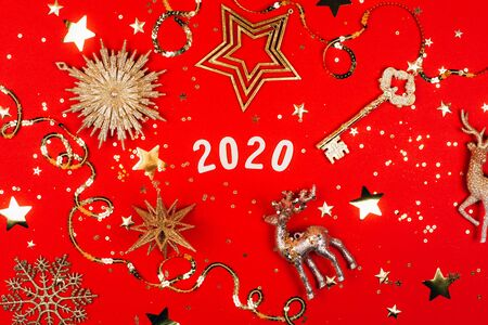2020 on red background with sparkles. Flat lay style.