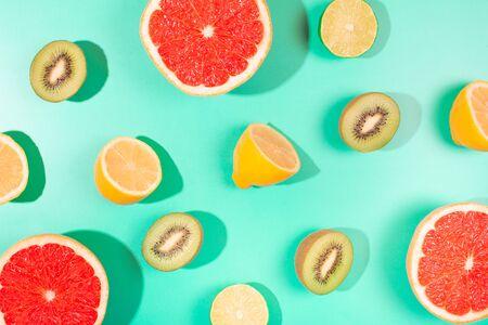 Fruits on trendy green background. Flat lay style. Фото со стока