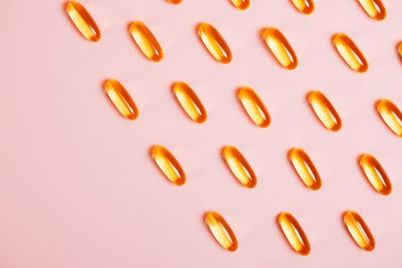 Capsules with oils for beauty. Concept of modern health-care. Flat lay style.