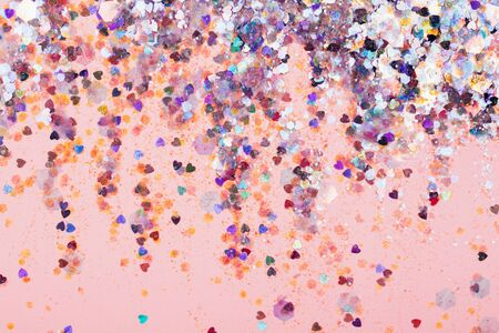 Falling confetti on bright background. Holiday and party concept. Фото со стока