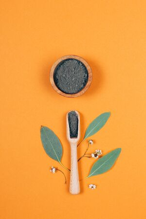 Home skin care. Grey clay with wooden spoon. Modern apothecary. Flat lay style. Фото со стока