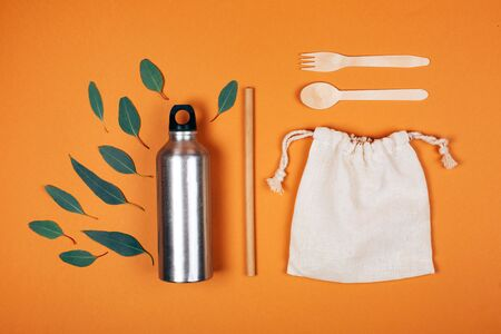 Zero waste set for picnic. Bottle, fork, spoon, tube for juice and bag. Flat lay style