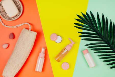 Care plastic-free cosmetics on pastel paper colorful background
