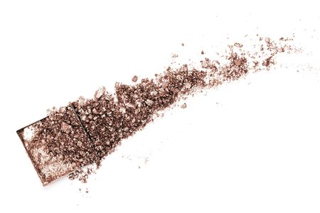 Brown crushed eyeshadows with shimmer. Cosmetics concept. Flat lay style.