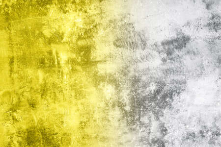 Demonstrating trendy colors 2021 - Gray and Yellow. Grunge dirty concrete wall background with space for text or image 免版税图像