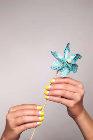 Perfect minimalistic manicure with geometry nail art in trendy colors of year 2021.