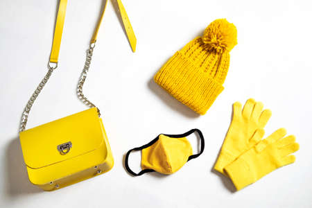 Colors of year 2021 - Gray and Yellow. Multiusage face mask and other objects that man needs to go outside.